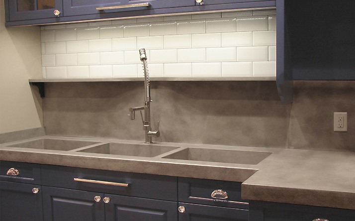 Gray kitchen counter tops made custom by Trueform Concrete.