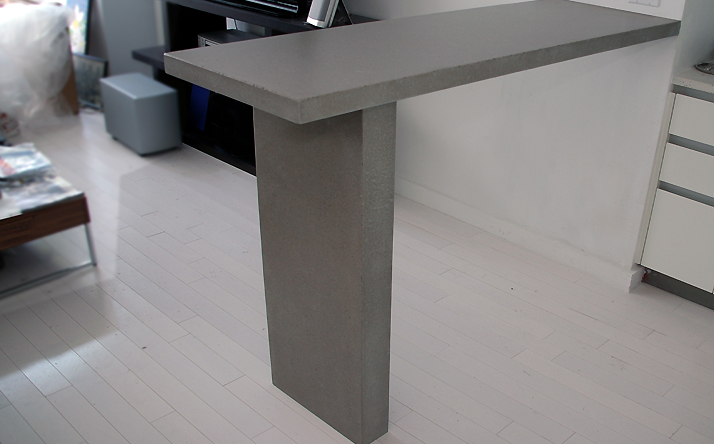Small gray custom concrete countertop for an apartment by Trueform.