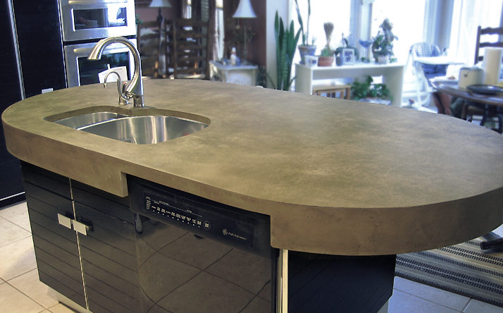 Oval, round shaped custom concrete counter with under mounted sink by Trueform.