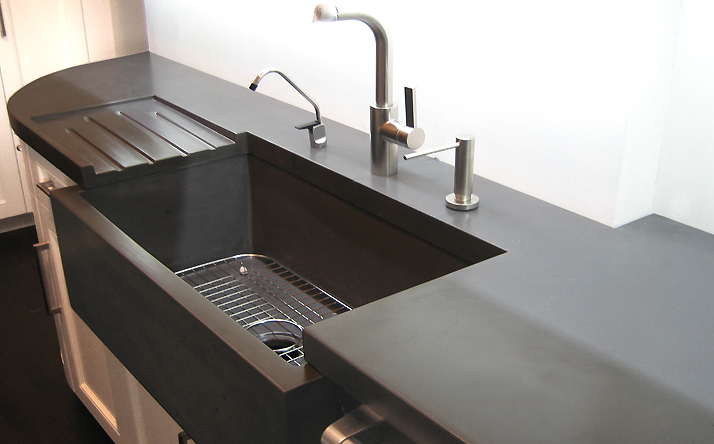 Completely custom black counter with under mount sink and dish drain. Trueform Concrete.