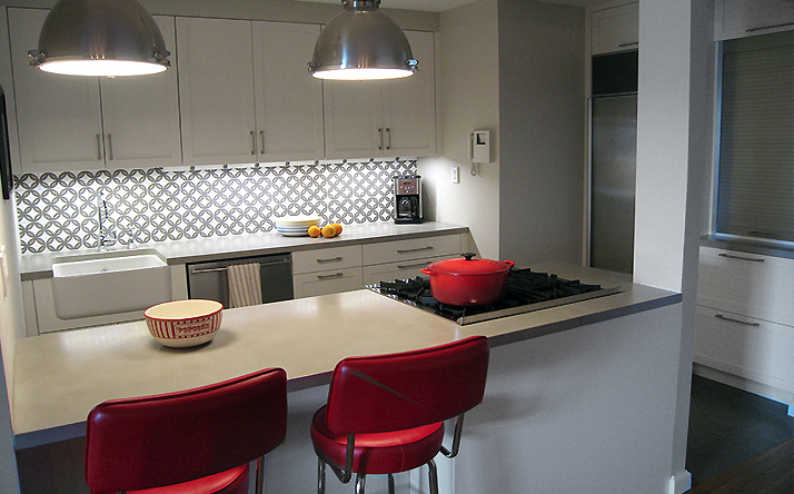 Custom twin kitchen concrete countertops with stove top. Truefrom.