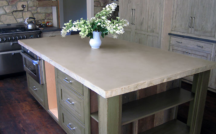 Custom concrete rectangle island counter top with wood base by Trueform Concrete.