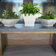 small dark gray custom concrete table with wood base by Trueform Concrete.