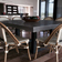 Dark gray Trueform custom Zen Square Concrete Dining Table used in a kitchen.
