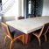Long light gray custom concrete conference table with wood base by Trueform Concrete.
