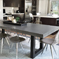 Dark gray Trueform zen Concrete Dining Table and painted metal base used in a kitchen.