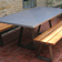 Gray custom outdoor concrete zen picnic table by Trueform Concrete.